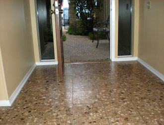 Before:  Terrazzo tile with dull surface.