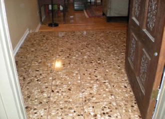 After: Shiny terrazzo tile after chemical etch.