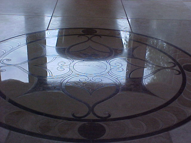 travertine with marble medallion inset after polishing
